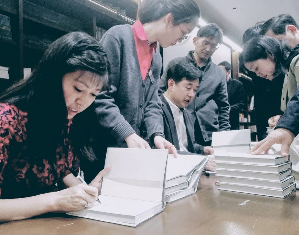 Nancy Liang and Chen Xianfa signing Poems in Nines