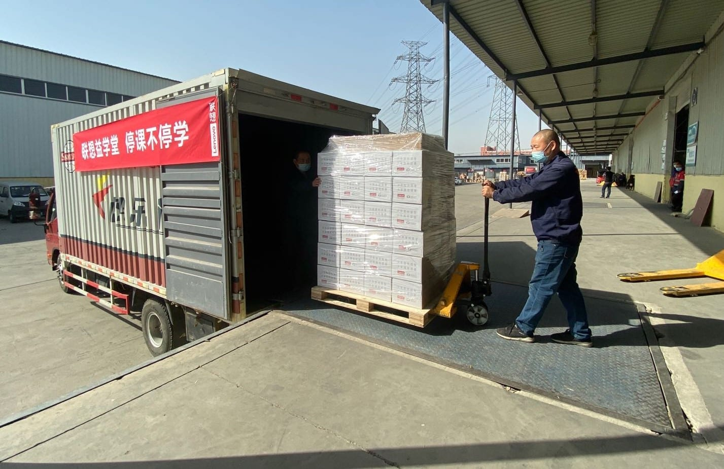 Special packages with tablet, data card, and letter from Yuanqing Yang being loaded for delivery in Hubei Province.