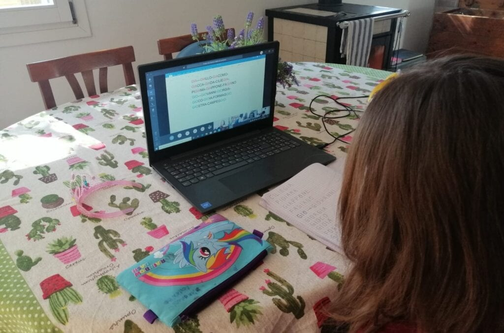 Student in Italy with her donated Lenovo PC