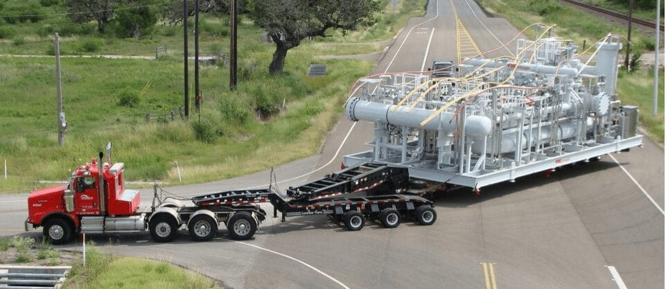 Lone Star Transportation truck towing a massive load of industrial equipment.