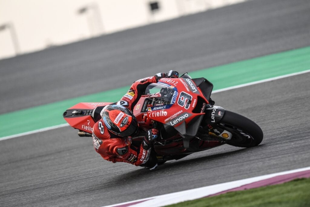 MotoGP bike taking a tight turn on the track