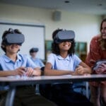 Young students wearing Lenovo VR headsets in school