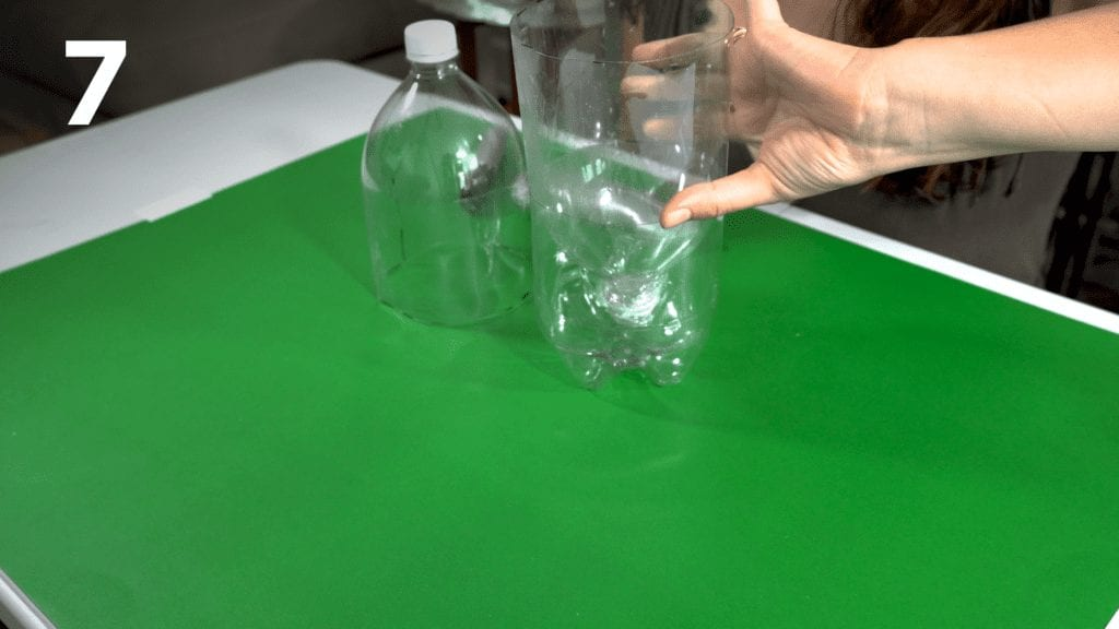 Flip the bottle with the plastic wrap and place inside the other piece of bottle.