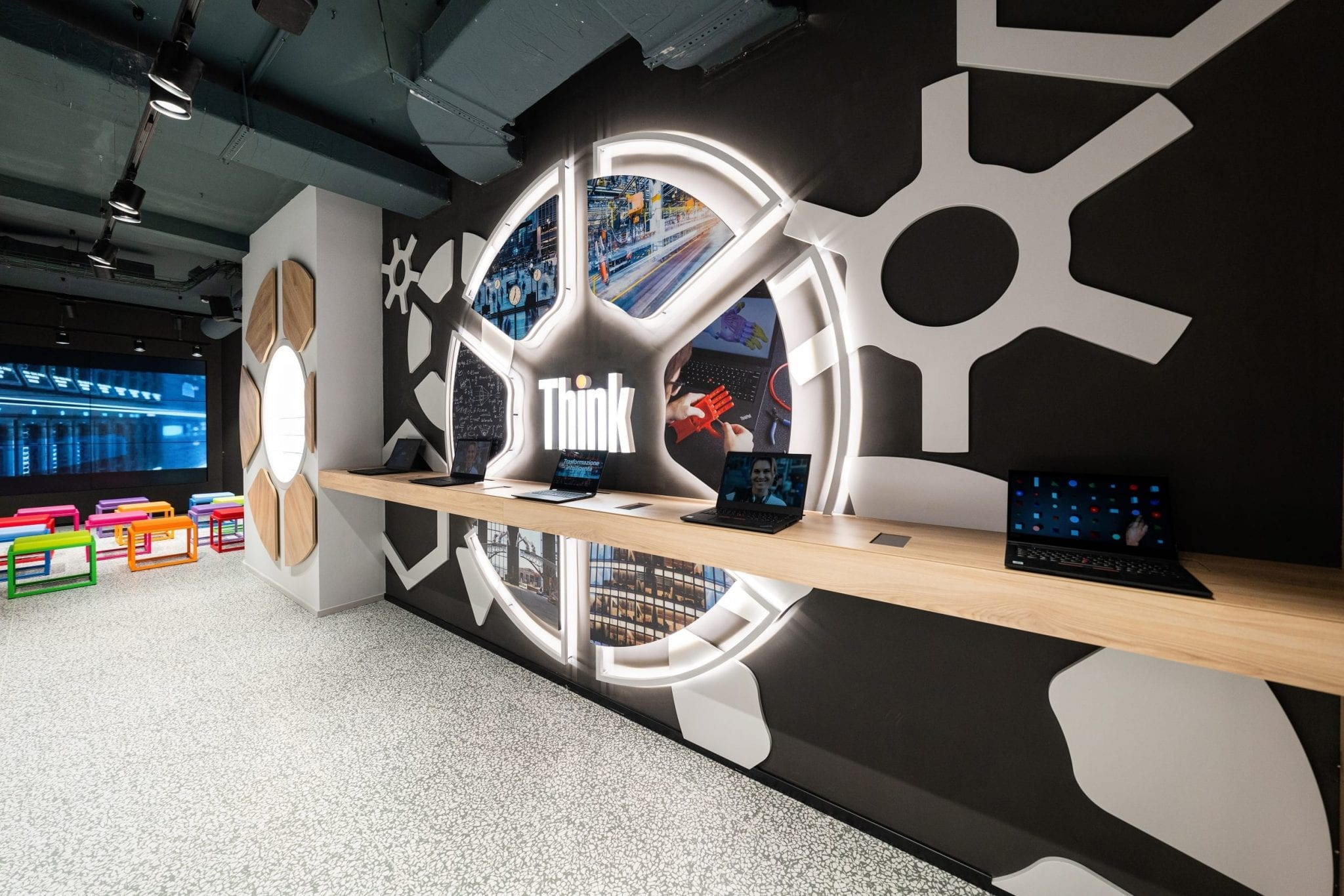 Spazio Lenovo concept store interior showing Think-branded devices and an open auditorium and workspace