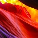 Brand image - looking up through a deep, multicolored canyon