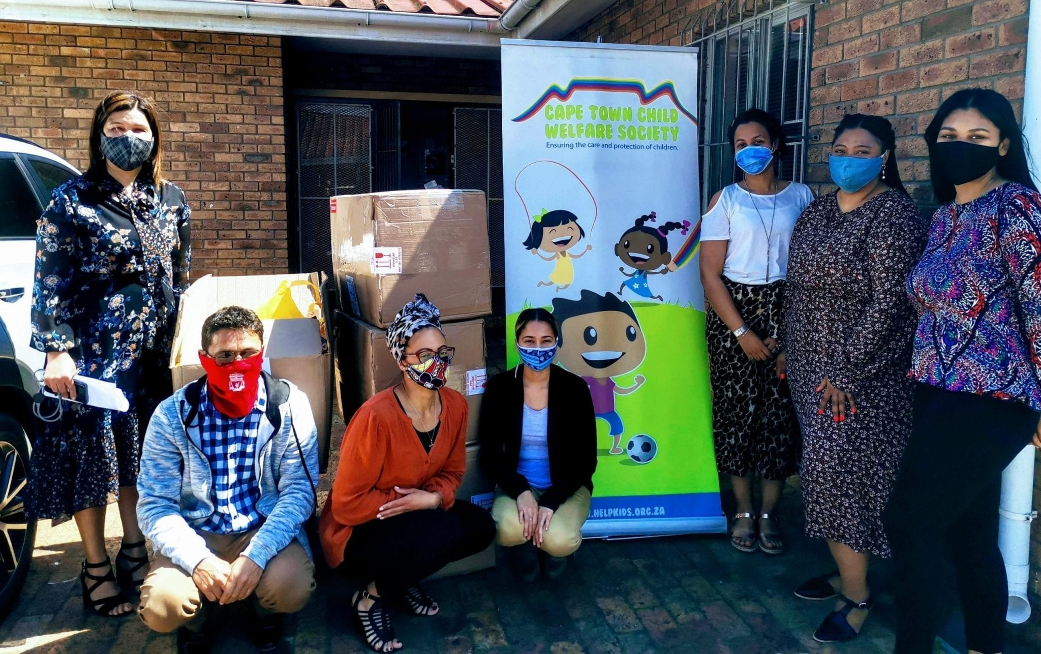 Volunteers standing by donations for the Cape Town Child Welfare Society