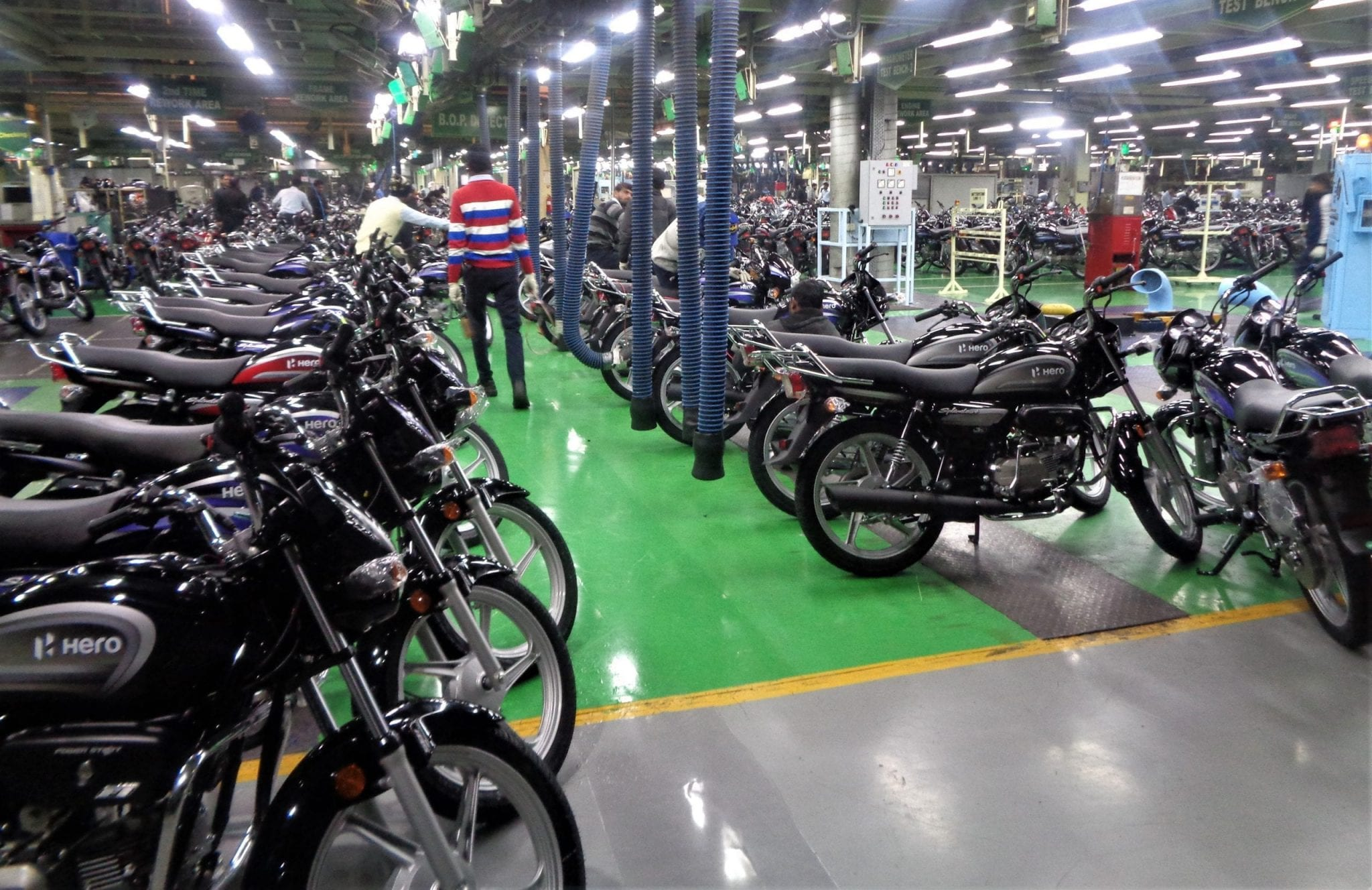 Hero MotoCorp warehouse with dozens of motorcycles lined up on display.