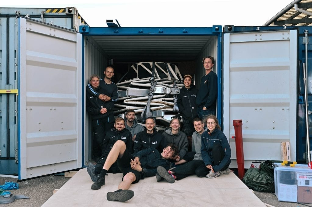 The Lunark team resting after successfully packing the habitat into a shipping crate for delivery to Greenland.