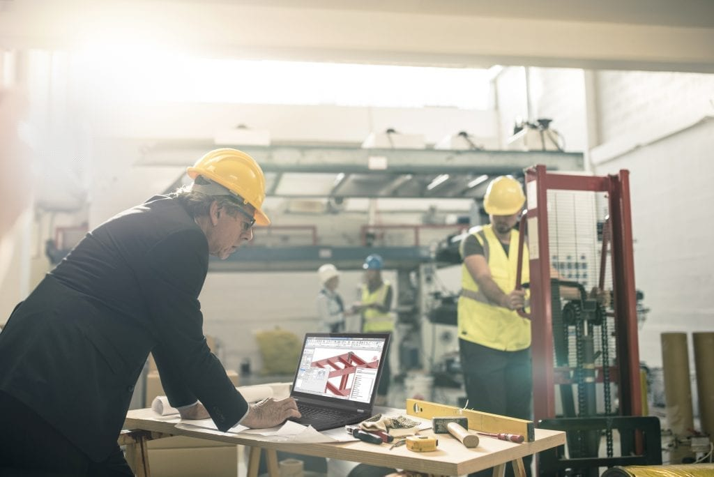 An architect using a ThinkPad P15 at the construction site.