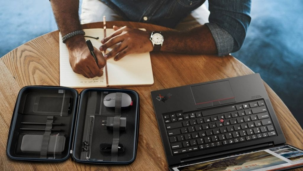 Lenovo Go accessories in tech organizer on table with someone working