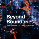 Beyond Boundaries: Innovation for a changing future (text on cityscape at night)