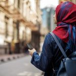 Lenovo brand image - woman exploring a city with smartphone in hand