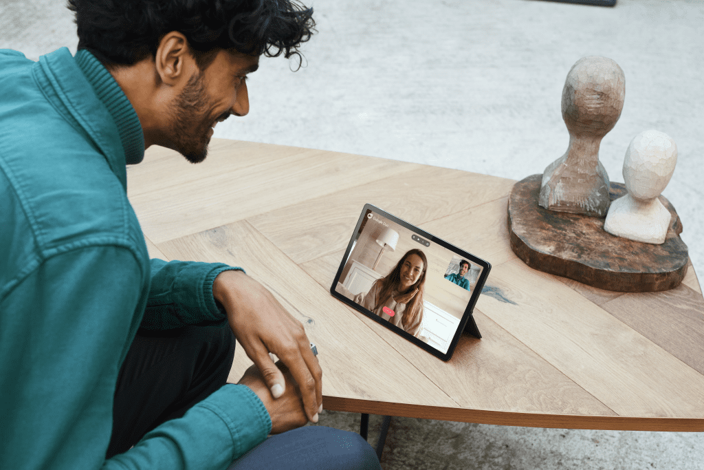 Person using Lenovo Tab P11 for a video call