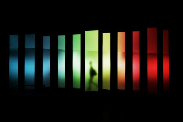 Lenovo brand image - figure passing by reflected rectangles of light