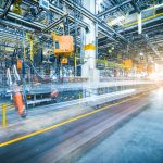 Lenovo brand image - manufacturing activities blurred in a large factory