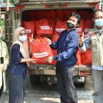 Volunteers unloading supplies at an orphanage in Jakarta